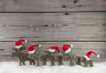 Wooden Christmas Background With A Group Of Santa Clause On Wood Stock Photo - 60913520