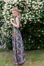 Beautiful Sexy Tender Blonde Girl In A Long Dress With Evening Hairstyle Standing In The Garden Near A Flowering Aromatic Tree Royalty Free Stock Photo - 60913535