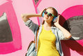 Pretty Cool Girl Wearing A Sunglasses, Headphones Listens To Music In City Stock Images - 60913854