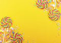 Rainbow Lollipop Candy On Bright Yellow Wood Table. Stock Photography - 60922692
