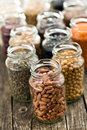 Various Dried Legumes In Jars Stock Photos - 60931923