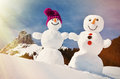 Snowmen Against Swiss Alps Royalty Free Stock Image - 60932026