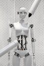 Futuristic White Robot Woman Being Made By The Machines Royalty Free Stock Photo - 60942745