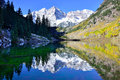Maroon Bells During Foliage Season With Snow Covered Mountains And Yellow Aspen Reflecting In The Lake Royalty Free Stock Photography - 60956097