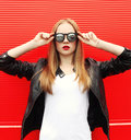 Fashion Portrait Pretty Stylish Woman With Red Lipstick Wearing A Rock Black Jacket And Sunglasses Stock Photos - 60971753