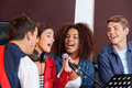 Singers With Band Members In Recording Studio Royalty Free Stock Photography - 60974127
