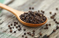 Whole Black Pepper On Wooden Spoon Royalty Free Stock Photos - 60975798