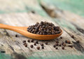Whole Black Pepper On Wooden Spoon Royalty Free Stock Photo - 60981535