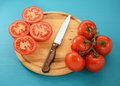 Tomatoes, Whole And Sliced With Knife On Wooden Board Stock Image - 60997491