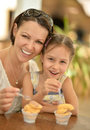 Girl With Mother Eating Royalty Free Stock Image - 61008146