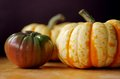 Black Heirloom Tomato And Carnival Squash Royalty Free Stock Photography - 61011687