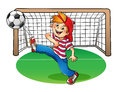 Boy In A Red Cap Kicking A Soccer Ball Royalty Free Stock Photo - 61027805