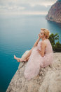 Bride In Wedding Dress Standing On A Rock Stock Photography - 61063782