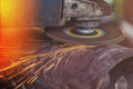 Worker Grinding Steel Pipe With Grinder Royalty Free Stock Image - 61064006