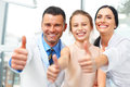 Dentist Doctor,  Assistant And Little Girl All Smiling At Camera Stock Photography - 61070822