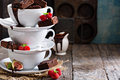 Brownies In Stacked Coffee Cups With Chocolate Sauce Stock Images - 61096234