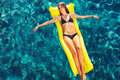 Woman Relaxing Floating On Raft In Pool Stock Photos - 61109973
