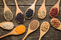 Various Dried Legumes In Wooden Spoons Stock Photos - 61116563