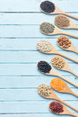 Various Dried Legumes In Wooden Spoons Stock Photography - 61117262