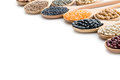 Various Dried Legumes In Wooden Spoons Royalty Free Stock Images - 61117459
