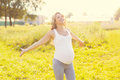 Happy Beautiful Smiling Pregnant Woman Enjoys Warm Sunny Day Stock Photography - 61124012