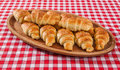 Croissant Bakery On Teakwood Table On Red And White Fiber Backgr Stock Photography - 61145272