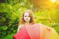 Little Girl With Rainbow Umbrella, Under Sunshine. Royalty Free Stock Photos - 61152108