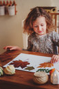 Child Girl Making Herbarium At Home, Autumn Seasonal Crafts Stock Images - 61159564