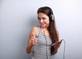 Beautiful Happy Young Woman Listen The Music Holding The Phone A Stock Images - 61230564