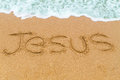 JESUS Inscription Written On Sandy Beach With Wave Approaching Royalty Free Stock Image - 61245496