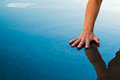 A Hand Stroke The Water Royalty Free Stock Photos - 61246778