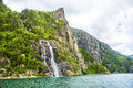 Famous Hengjanefossen Waterfall Coming Down From A Steep Rock Face Into Lysefjord. Stock Photography - 61270212