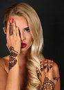 Sensual Woman With Blond Hair With Henna Tattoo On Hands Stock Photo - 61272970