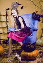 Blond Cute Girl In Halloween Interior With Pumpkin Royalty Free Stock Photography - 61299867