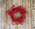 Red Holly Berry Wreath On Aged Wooden Boards Royalty Free Stock Photography - 61311247