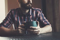 Man Sitting With Cup Of Morning Coffee Or Tea Royalty Free Stock Image - 61325976