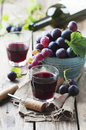 Red Wine And Grape On The Wooden Table Royalty Free Stock Photos - 61366628