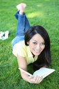 Young Woman Reading Book In Park Royalty Free Stock Photo - 6148125