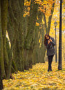 Brunette Posing Against The Backdrop Of Autumn Trees. Lonely Woman Enjoying Nature Landscape In Autumn. Stock Photos - 61407213