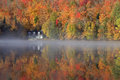Autumn Colors And Fog Reflections On The Lake, Quebec, Canada Royalty Free Stock Photo - 61409645