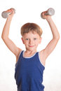Boy Blue Shirt Doing Exercises With Dumbbells Over White Backgro Royalty Free Stock Photography - 61415867