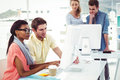 Creative Business Team Working Hard Together On Pc Royalty Free Stock Photos - 61431538