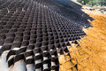 Close Up Of Slope Erosion Control With Grids And Earth On Steep Slope Stock Photography - 61433722