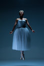 Portrait Of The Ballerina On Blue Background Royalty Free Stock Photo - 61460145