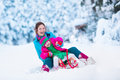 Mother And Child Sledding In A Snowy Park Stock Photo - 61474210