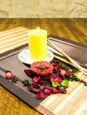 Composition Of Red, Green Home Decorating Flowers And Leaves And A Yellow Candle On A Table Royalty Free Stock Photos - 61482008