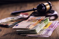Justice And Euro Money. Euro Currency. Court Gavel And Rolled Euro Banknotes. Representation Of Corruption And Bribery In The Judi Stock Photography - 61497872