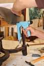 An Upholsterer Repairing An Armchair With Stapler Royalty Free Stock Photography - 61513657