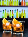 Two Glasses Of Spritz Aperitif Aperol Cocktail With Orange Slices And Ice Cubes On Bar Table, Disco Atmosphere Background Stock Photos - 61537973