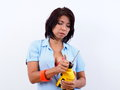 Beautiful Woman Inserts Chuck Key In Electric Drill Stock Images - 61562654